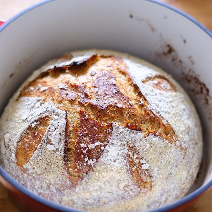 Close up of a freshly baked sourdough bread in a dutch oven