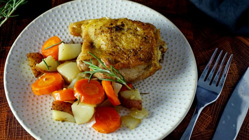 Dutch oven chicken thigh and vegetables on a plate