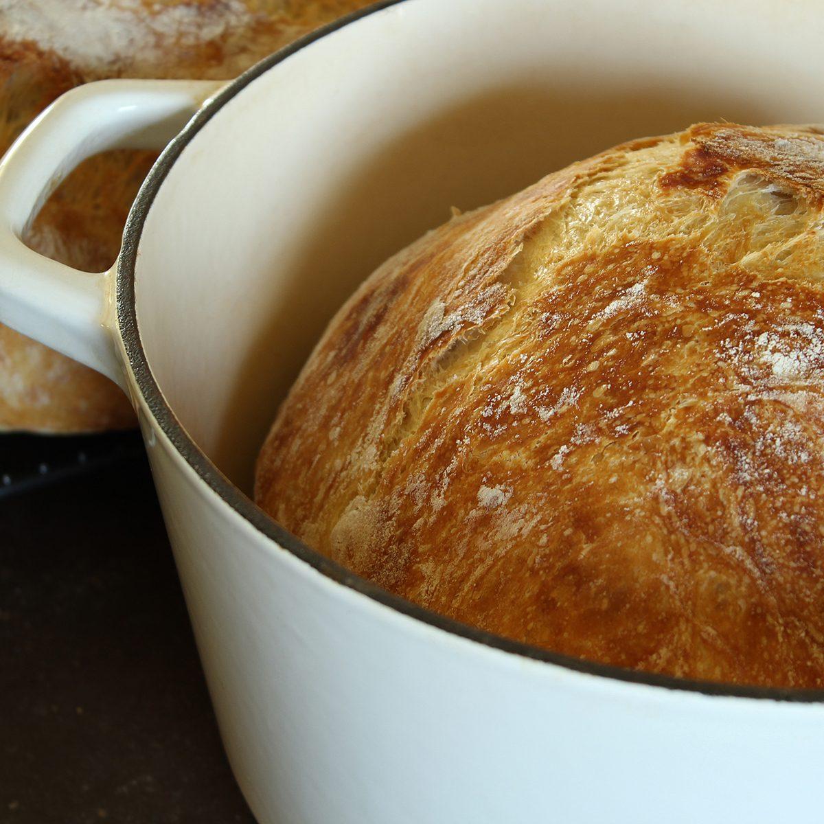 Freshly baked artisan bread in dutch oven.