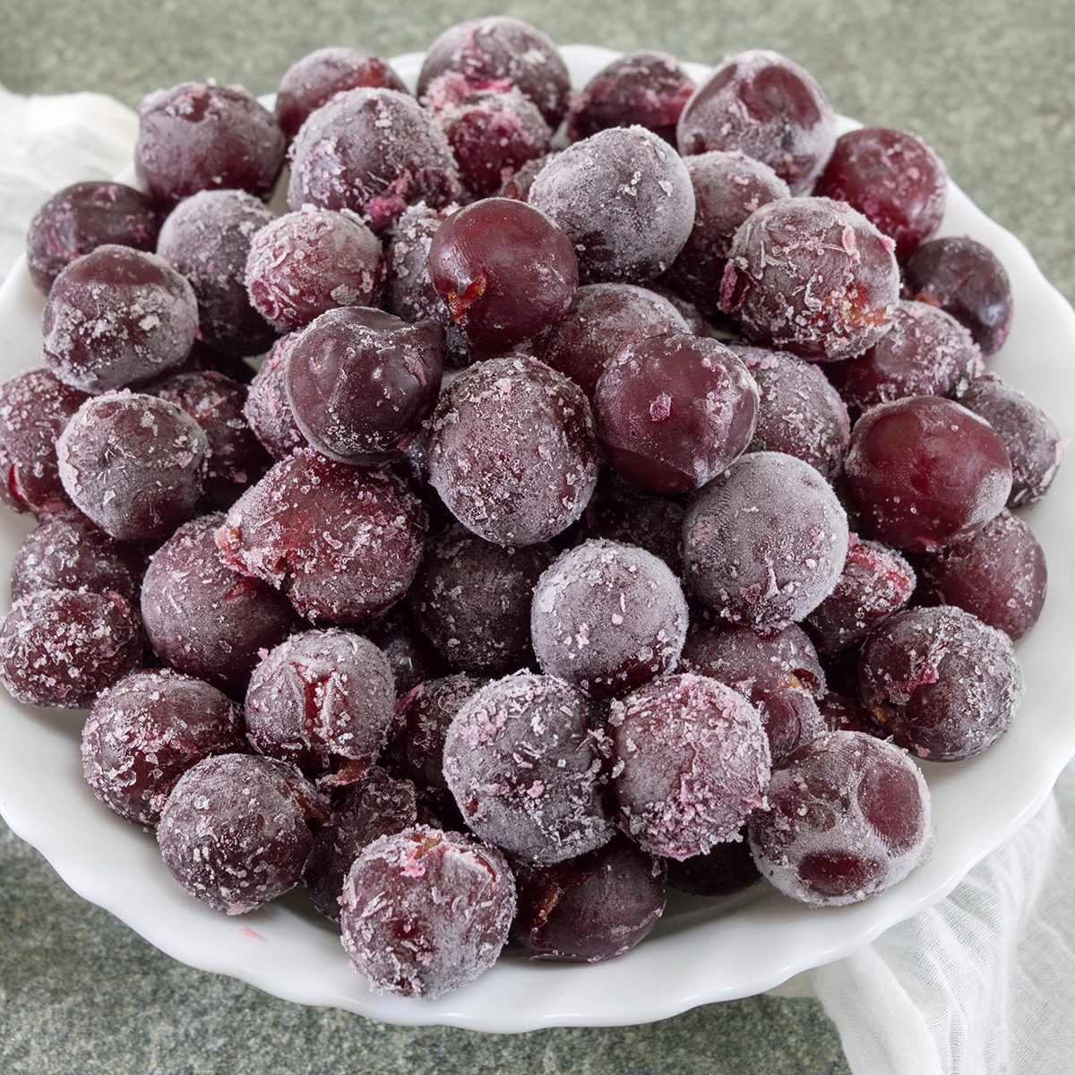 Frozen grapes served in a white bowl