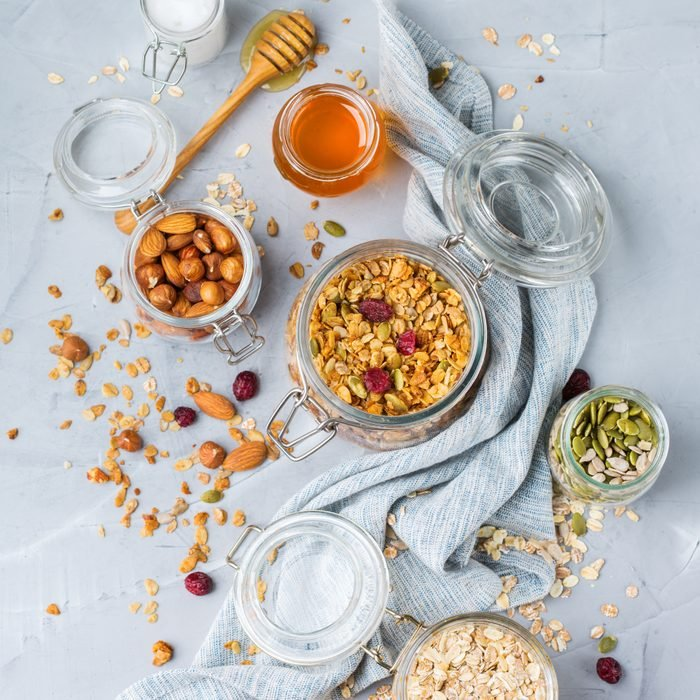 Healthy clean eating, dieting and nutrition, fitness, balanced food, breakfast concept. Homemade granola muesli with ingredients on a table. Top view flat lay background; Shutterstock ID 1420777223; Job (TFH, TOH, RD, BNB, CWM, CM): Toh Healthy Snack