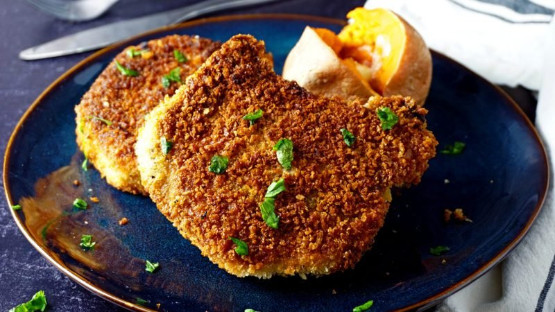 perfectly fried pork chops with a sweet potato