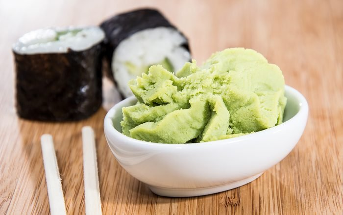 Maki rolls with Wasabi on wooden background