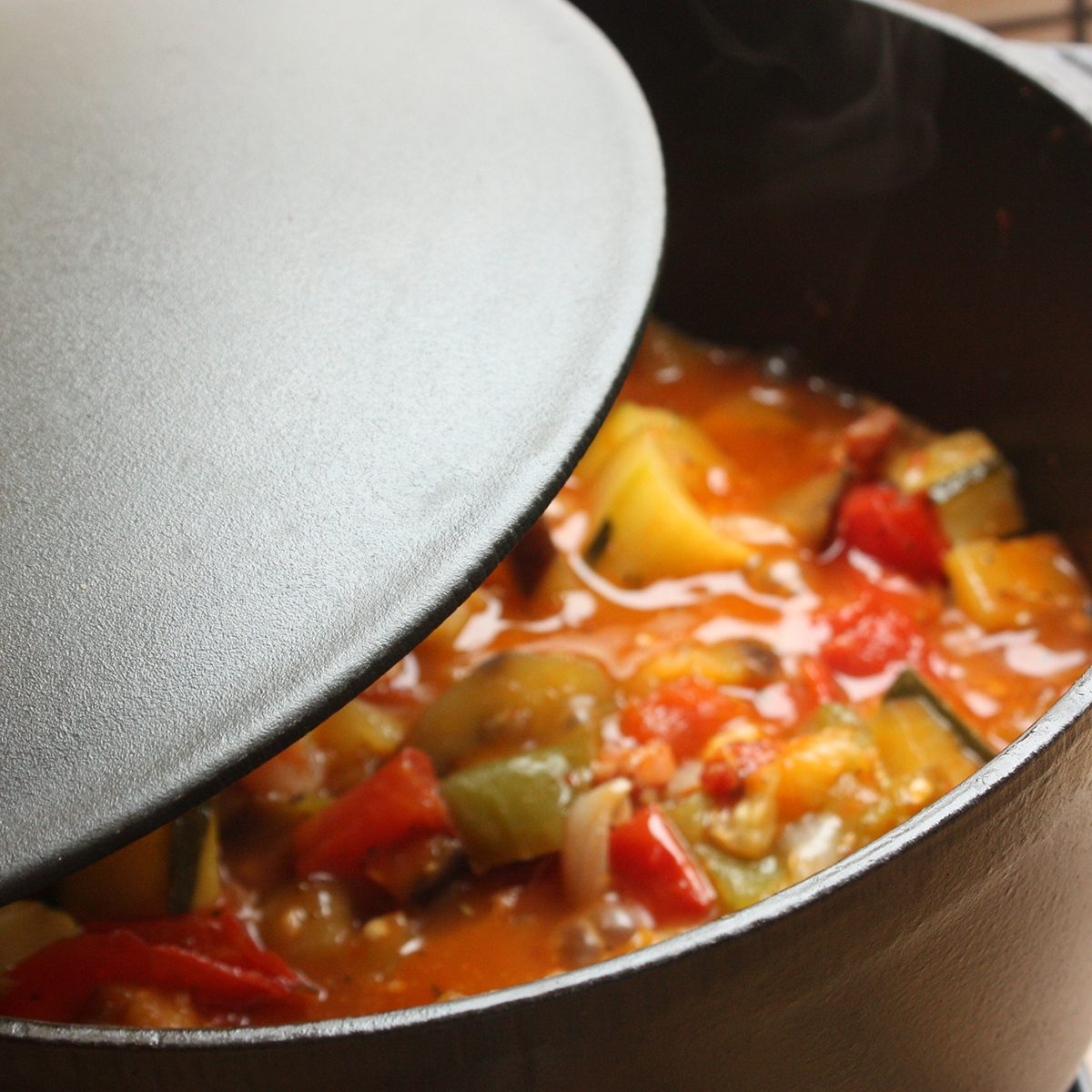 Ratatouille being cooked in a cast iron casserole Stewed dish French cooking