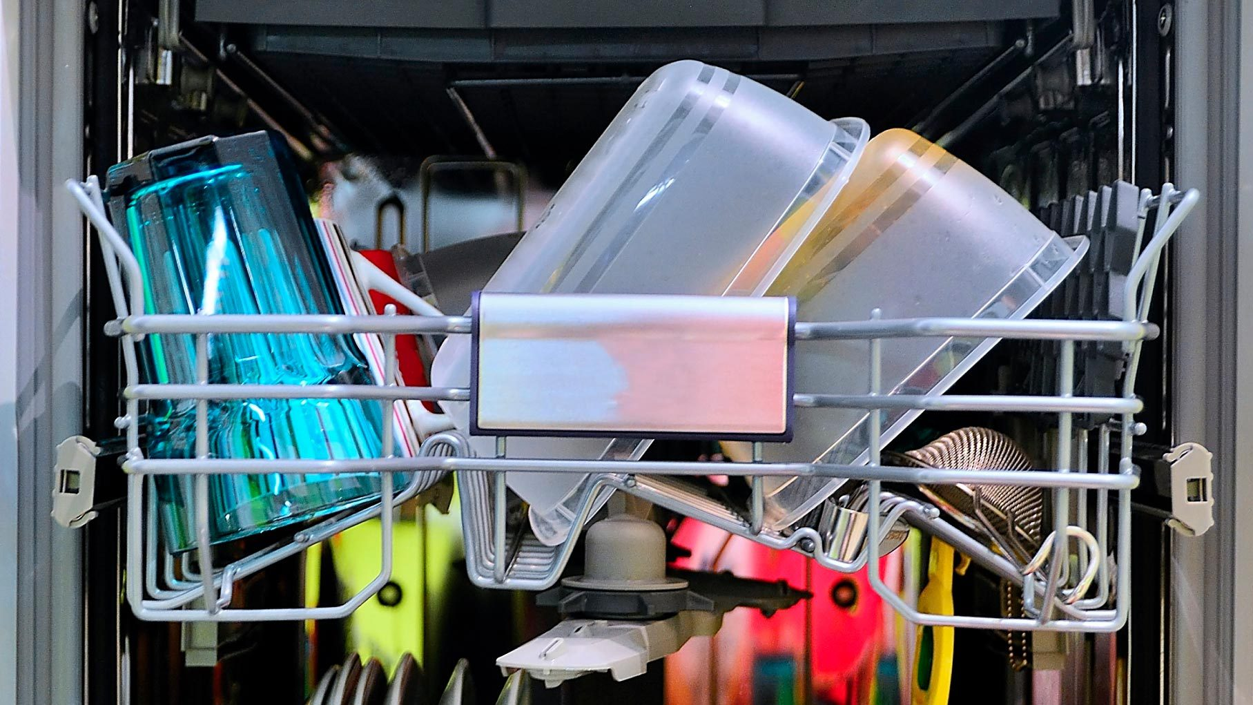 Front view of fully loaded dishwasher with washed clean dishes.