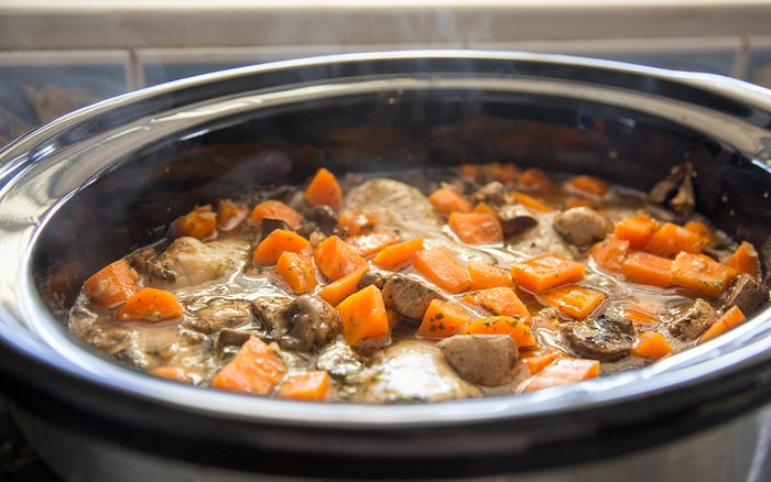 Chicken, carrots and mushrooms cooking in a slow cooker. Chicken Chasseur.