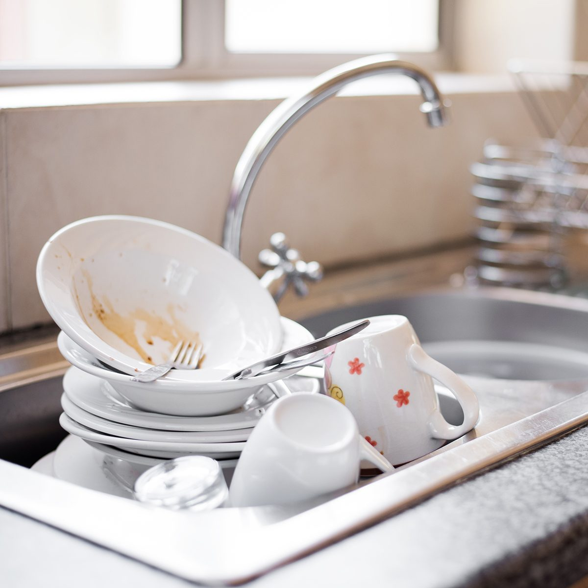Shot of kitchen sink full of dirty dishes