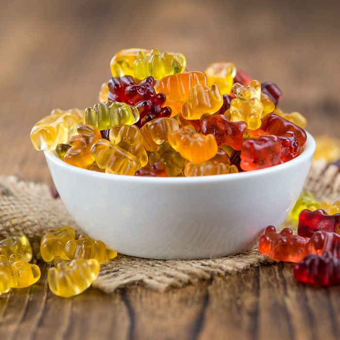 Fruity Gummy Bears (close-up shot) on an old wooden table