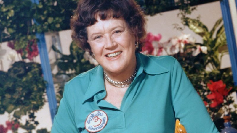 A portrait of the American chef Julia Child (1912 - 2004) shows her standing with a cut of meat in her kitchen, late 20th century. (Photo by Bachrach/Getty Images)