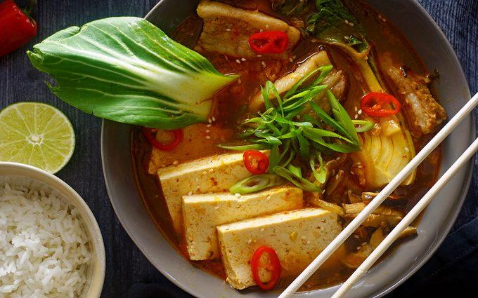 Close up shot of kimchi soup overhead