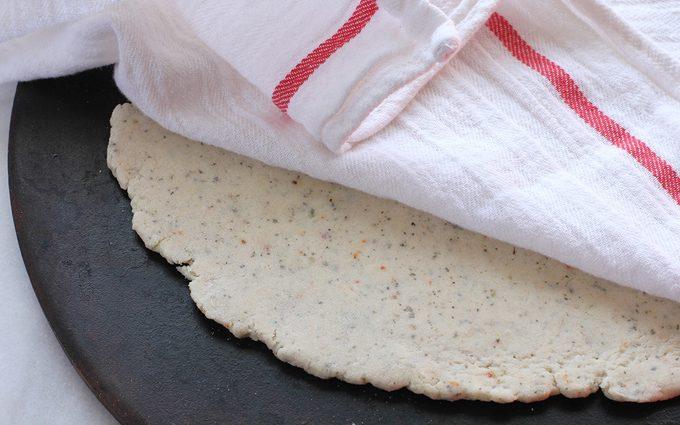 Dough resting under a tea towel