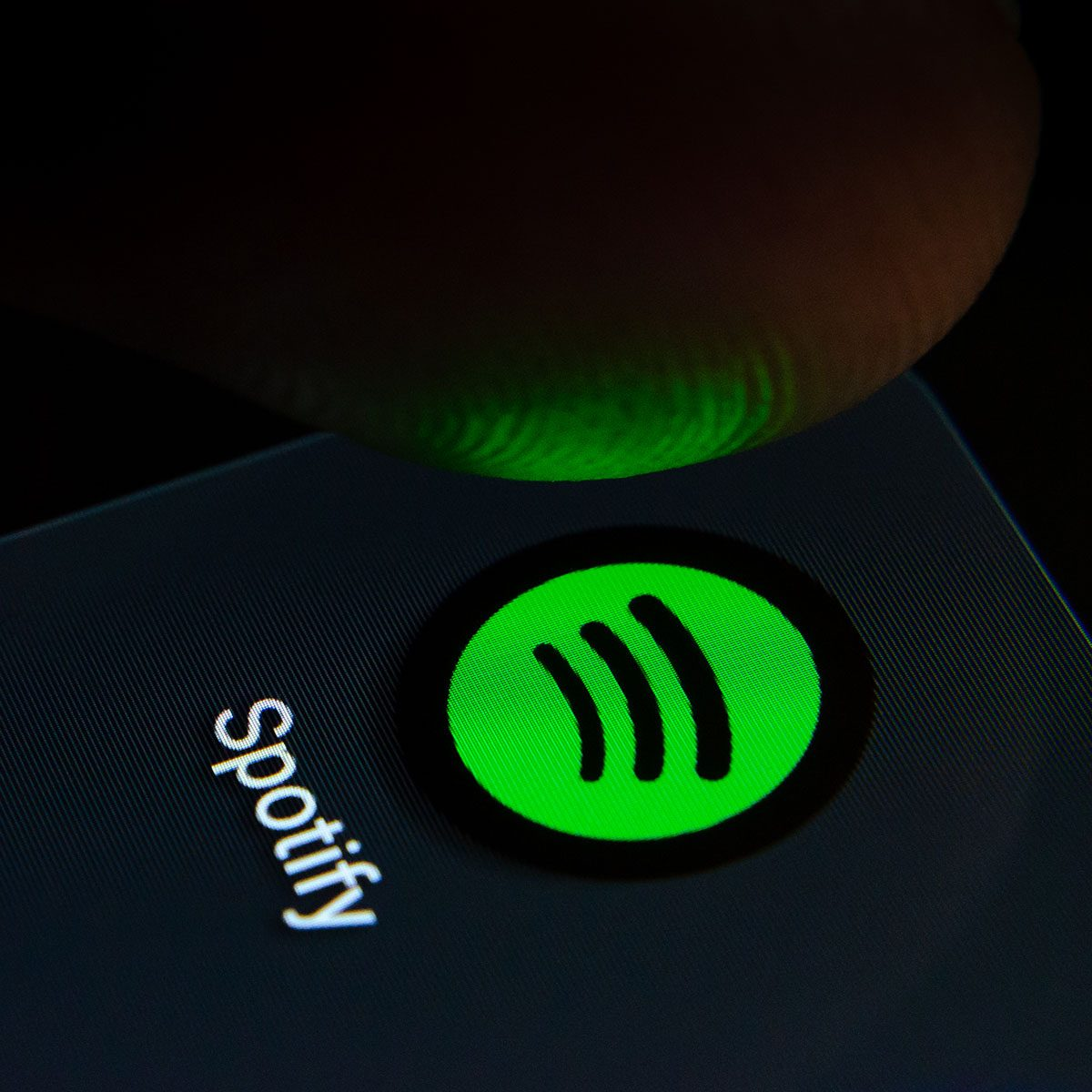 Stone, Staffordshire / United Kingdom - July 28 2019: Spotify app icon on the smartphone screen with visible pixels and the finger about to launch it. Extreme close up photo.; Shutterstock ID 1463748425; Job (TFH, TOH, RD, BNB, CWM, CM): tfh