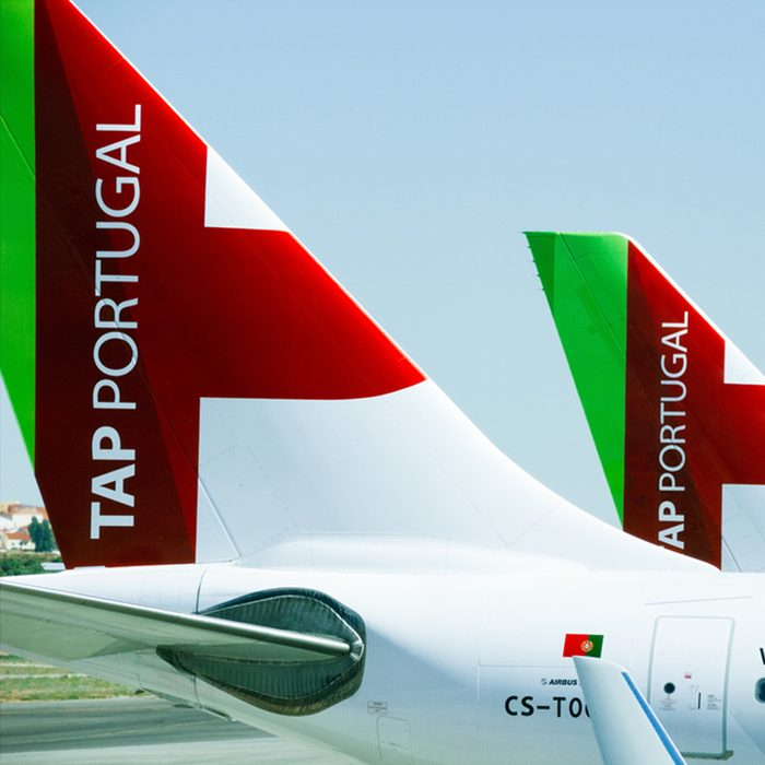 LISBON, PORTUGAL - JUNE 27 2015: Tails of four airplanes of the TAP Portugal airline company standing on the ground in a row.; Shutterstock ID 473300407; Job (TFH, TOH, RD, BNB, CWM, CM): RD