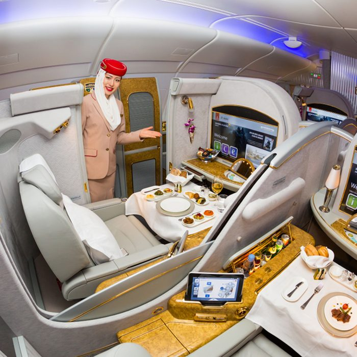 Dubai, UAE - NOVEMBER 12, 2017: Emirates Airline flight attendant. Emirates first class. Onboard food, dining. Luxury travel. Airbus A380. First class suite.; Shutterstock ID 768501814; Job (TFH, TOH, RD, BNB, CWM, CM): RD