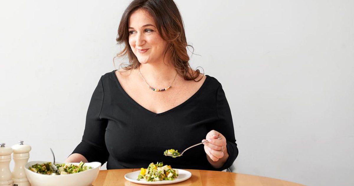 Deb Perelman posing while eating food