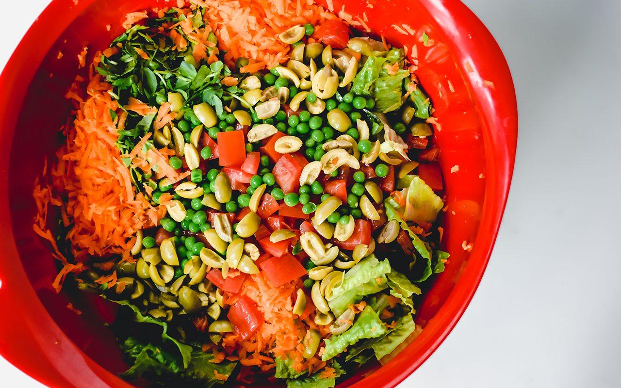 Salad ingredients in red bowl