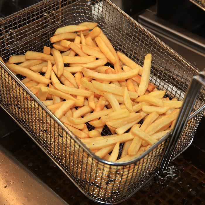 French Fries in Fry steel Basket on Street Market in Germany