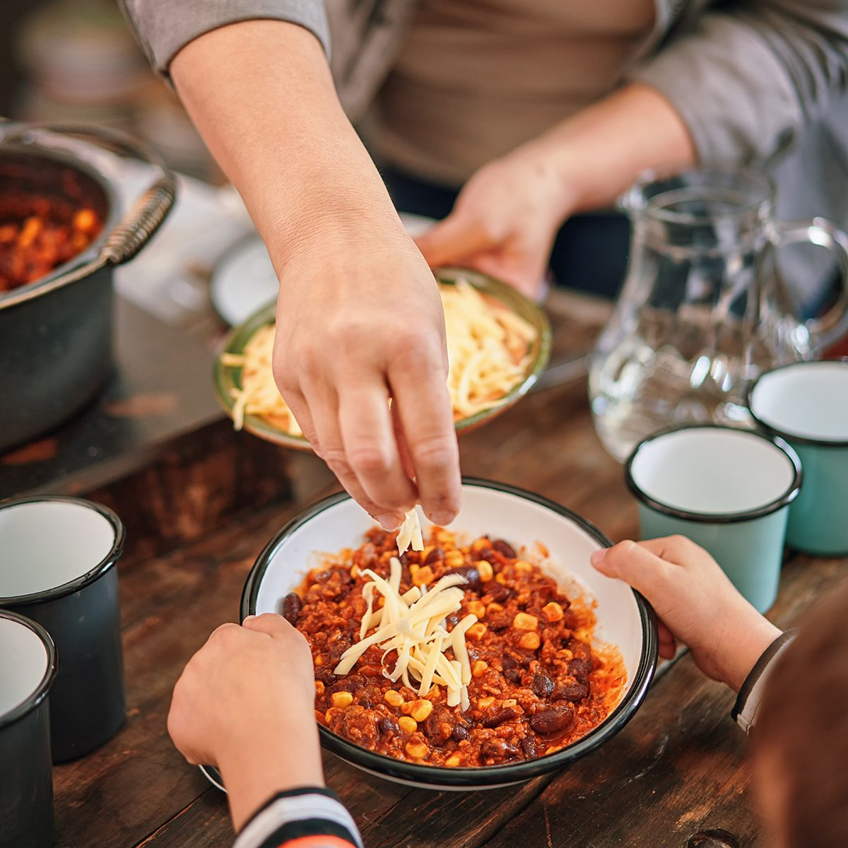 Young Family Eating Chili Con Carne