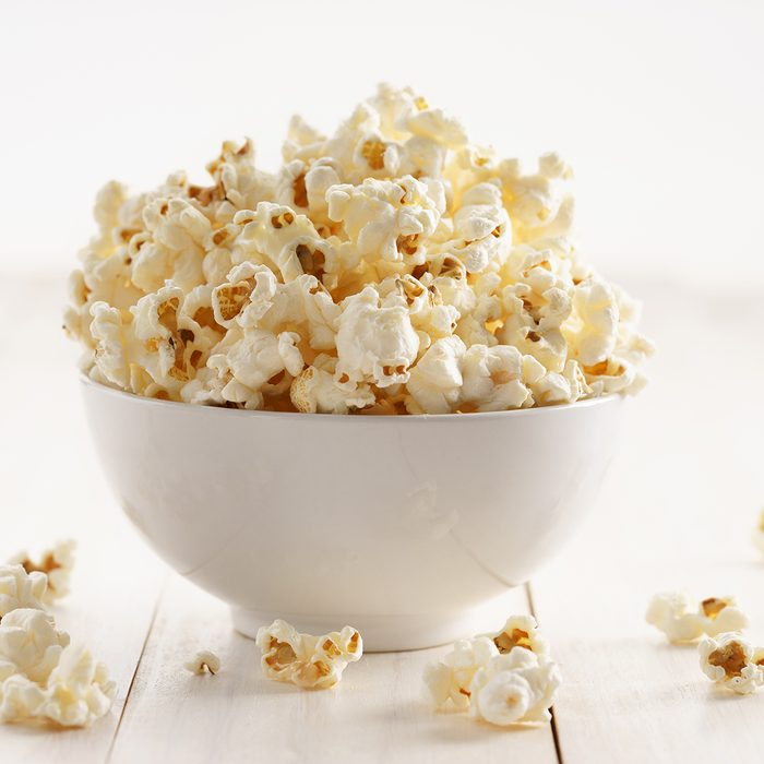 popcorn with caramel in a white porcelain bowl