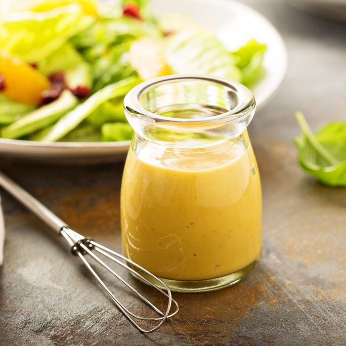 Homemade honey mustard salad dressing in a jar