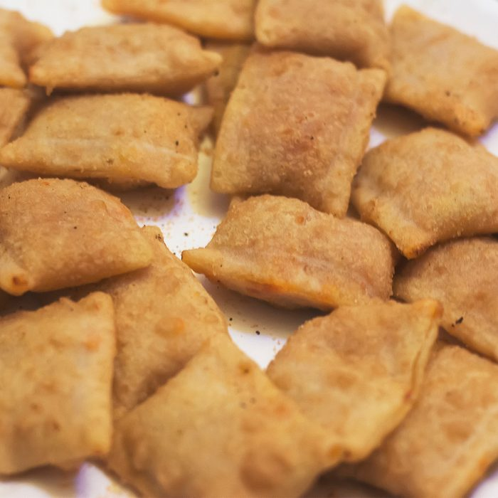 Pizza rolls on a white background at an angled view.