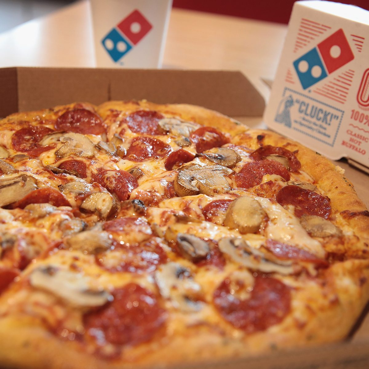 CHICAGO, IL - OCTOBER 12: Domino's menu items are shown on October 12, 2017 in Chicago, Illinois. Shares of the restaurant chain fell 4 percent today despite reporting an increase of more than 8 percent in domestic same-store sales. (Photo Illustration by Scott Olson/Getty Images)