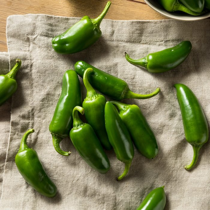 Raw green Organic Jalapeno Peppers Ready to Cook
