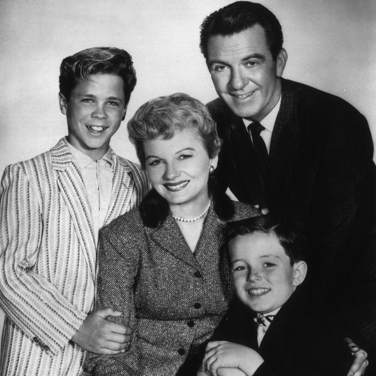 circa 1957: American actors (clockwise, from left) Tony Dow, Hugh Beaumont (1909 - 1982), Jerry Mathers, and Barbara Billingsley pose together in a promotional portrait for the television series, 'Leave It to Beaver'. (Photo by CBS Photo Archive/Getty Images)