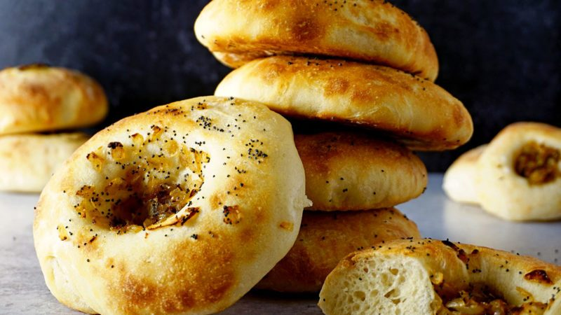 fresh baked bialys filled with caramelized onions and poppyseeds