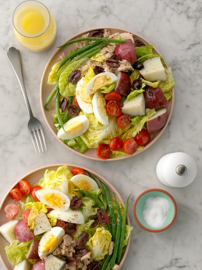 Nicoise salads on table.