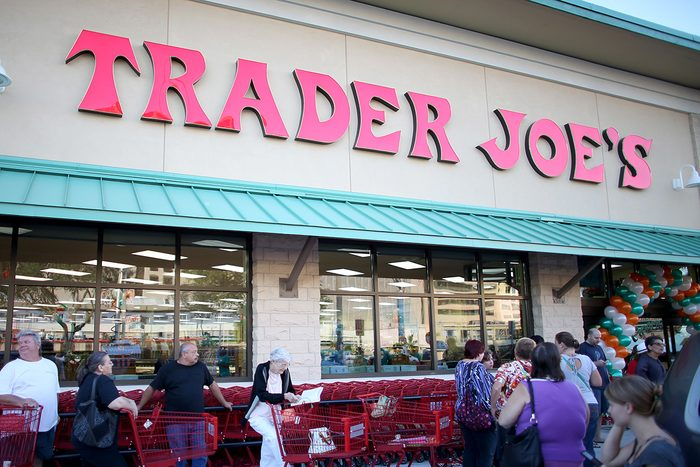 PINECREST, FL - OCTOBER 18: Shoppers lineup as they wait for the grand opening of a Trader Joe's on October 18, 2013 in Pinecrest, Florida. Trader Joe's opened its first store in South Florida where shoppers can now take advantage of the California grocery chains low-cost wines and unique items not found in other stores. About 80 percent of what they sell is under the Trader Joe's private label. (Photo by Joe Raedle/Getty Images)