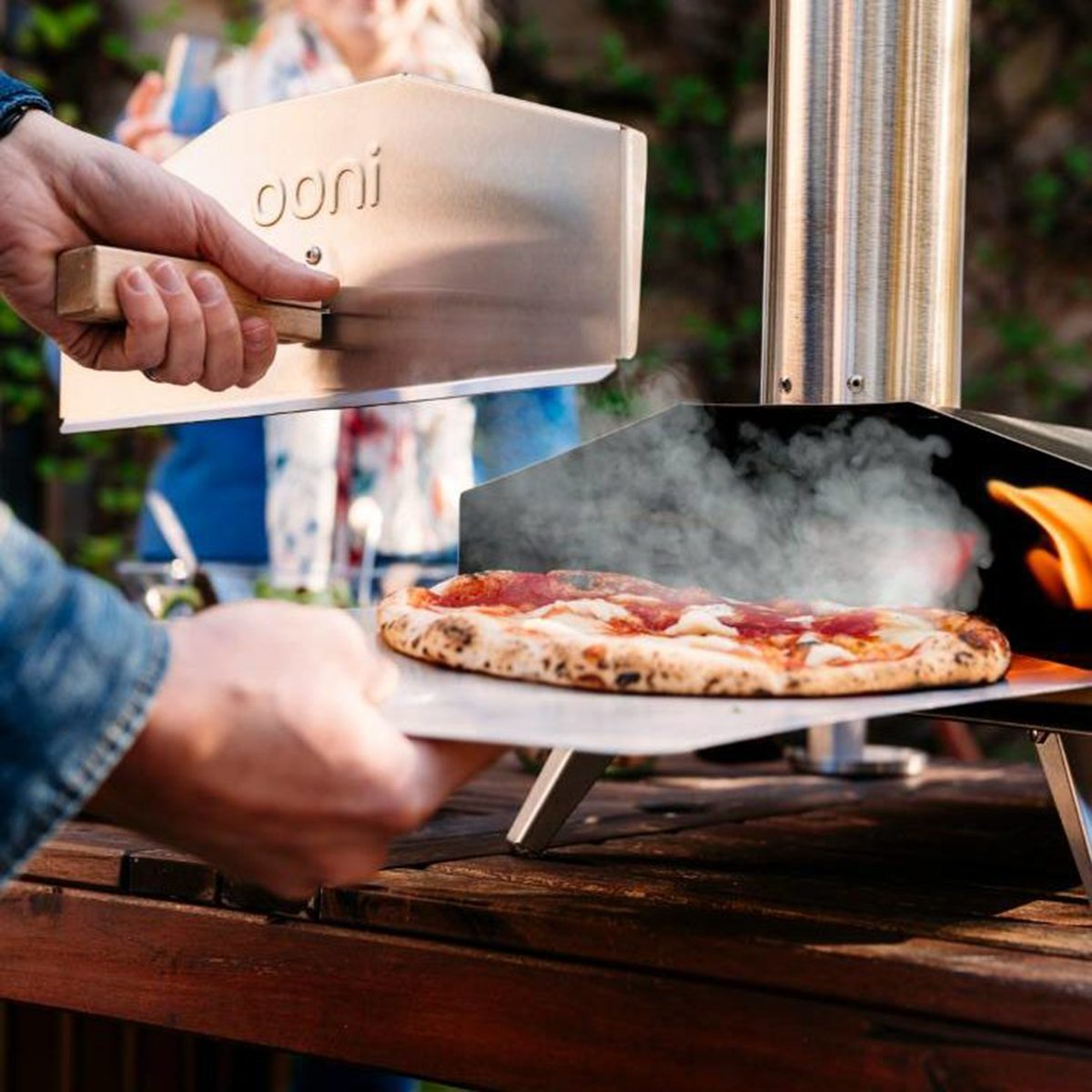 Throw a pizza party to create Italian vacation vibes