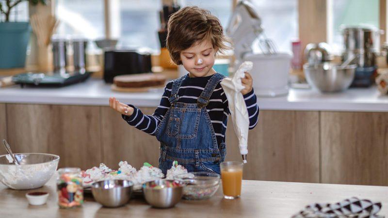 Boy Making Sweet Chocolate Muffins