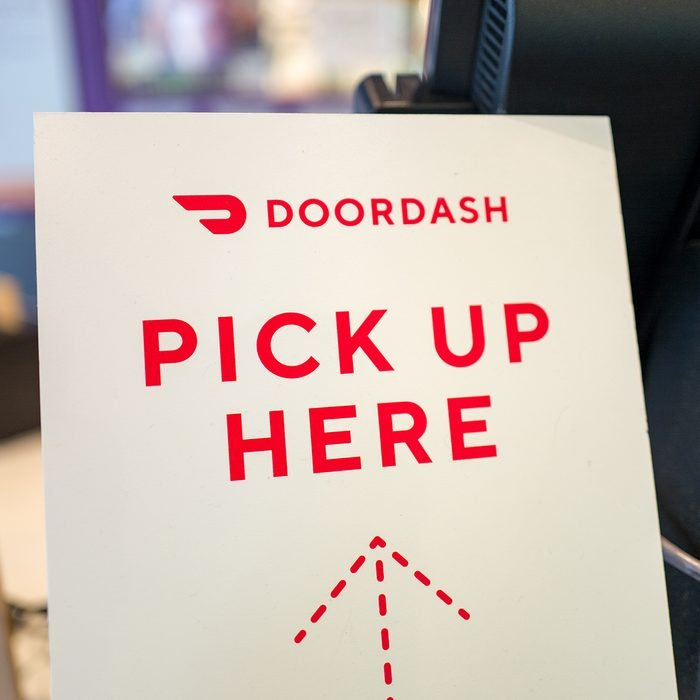 Close-up of sign for gig economy meal delivery app Doordash, with text reading Doordash Pick up Here, in a restaurant setting in Lafayette, California, May 23, 2019. (Photo by Smith Collection/Gado/Getty Images)