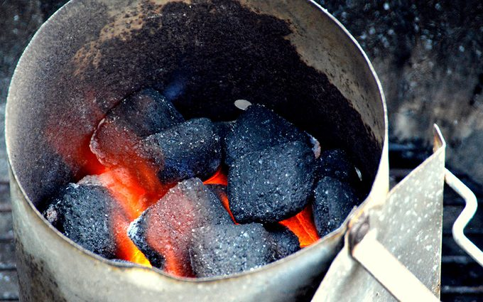 Coal briquettes lit in the barbecue