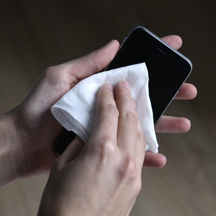 To avoid microbial contamination: clean your phone. (Photo by: TIROT/BSIP/Universal Images Group via Getty Images)