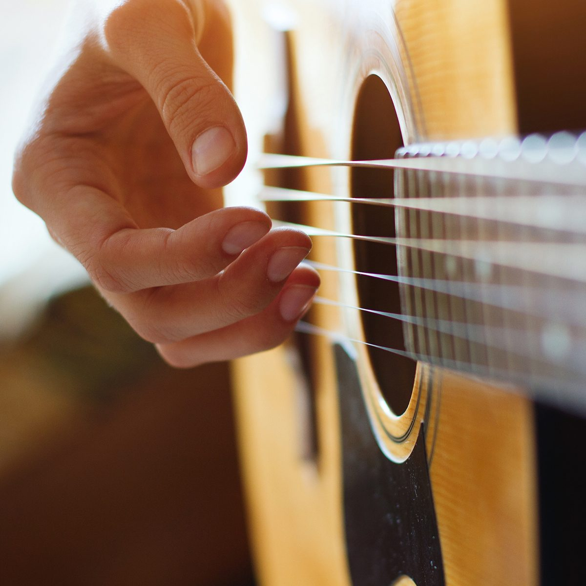 play acoustic guitar, close up of the hands