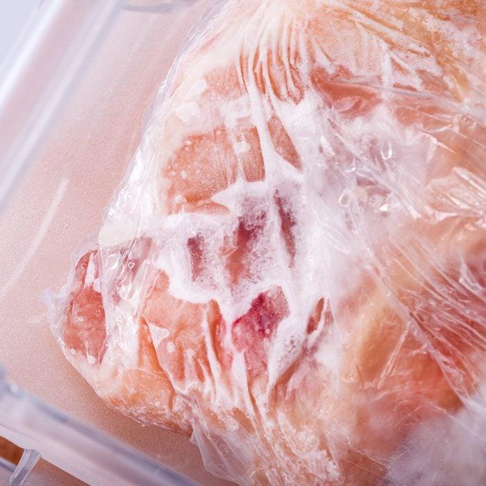 Four drawer freezer, full meet and chicken in studio shot