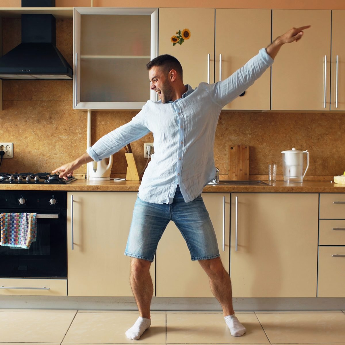 Man dancing in his kitchen