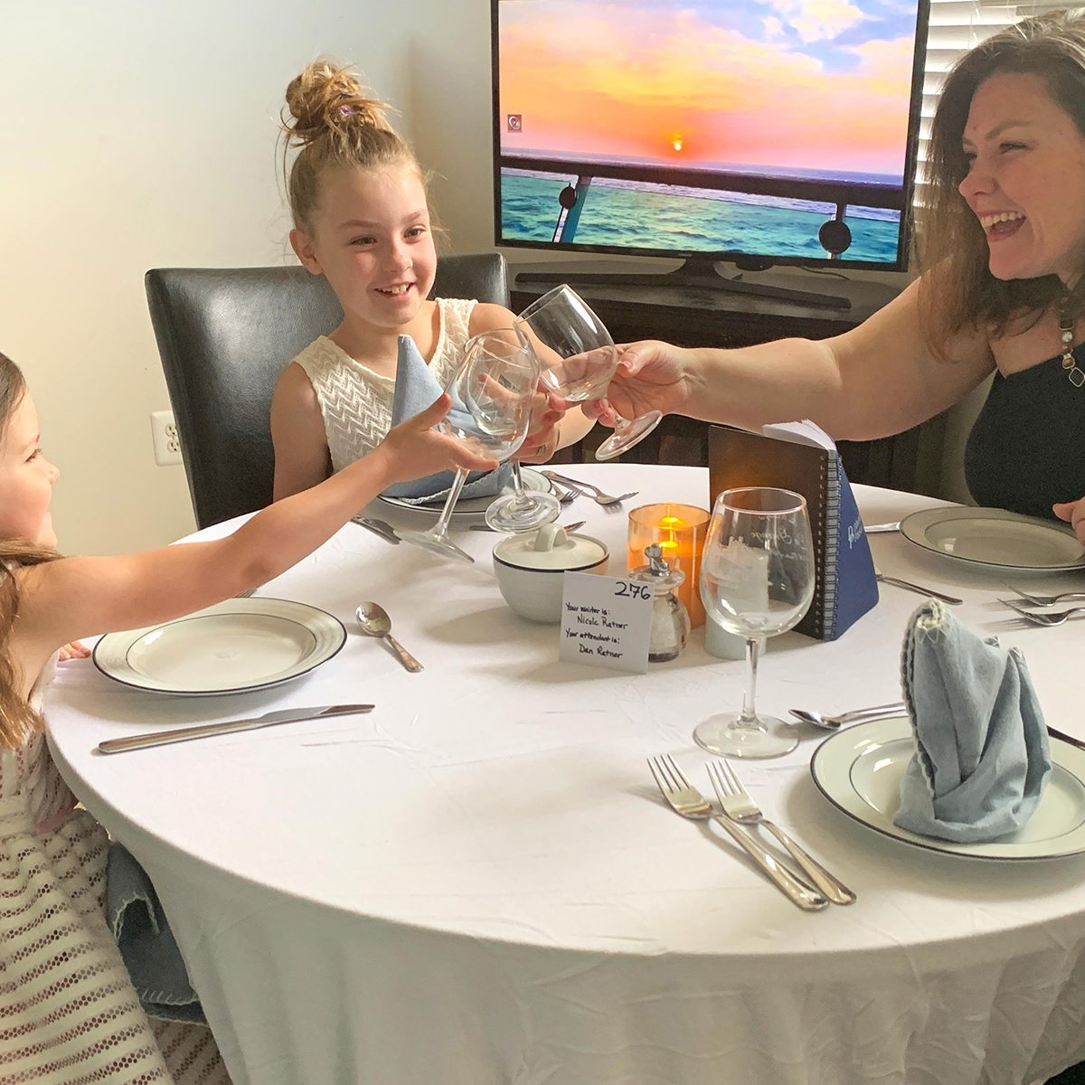 Mother and two kids having a fancy dinner at home