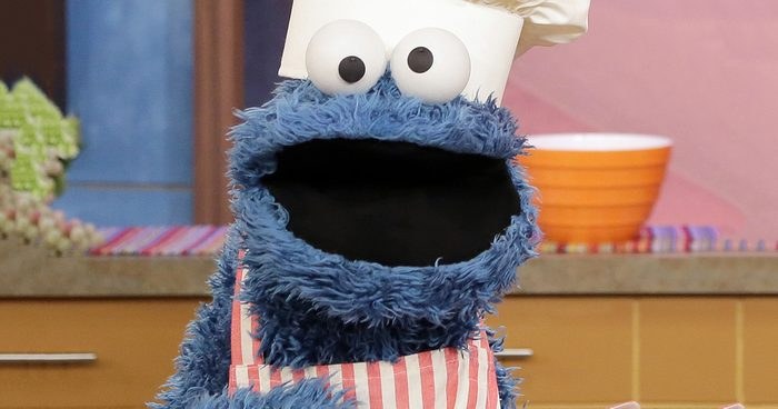 """MIAMI, FL - JULY 12: Cookie Monster is seen during Sesame Street's visit of Univision's """"Despierta America"""" at Univision Headquarters on July 12, 2013 in Miami, Florida. (Photo by Alexander Tamargo/WireImage)"""