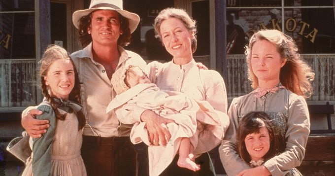 The cast of the television series 'Little House on the Prairie' with a dog on the set of the show, mid 1970s. Clockwise from left: American actors Melissa Gilbert, Michael Landon (1936 - 1991), Karen Grassle, who holds an unidentified baby, Melissa Sue Anderson, and Lindsay or Sidney Greenbush. (Photo by Fotos International/Getty Images)
