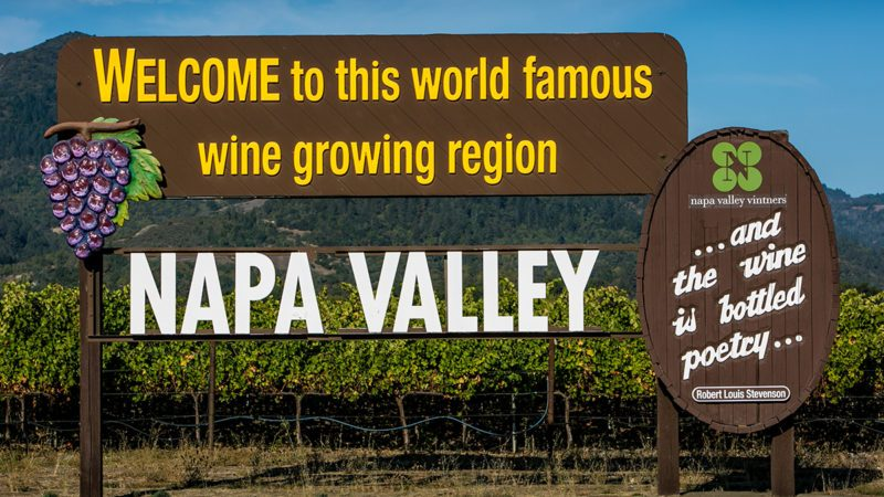 "RUTHERFORD, CA - OCTOBER 15: A large ""welcome"" sign greets visitors to the Napa Valley as viewed on October 15, 2015, in Rutherford, California. Nearly 4 million domestic and international travelers visit Napa Valley each year, generating jobs in the arts, entertainment, recreation, food service, and lodging sectors. (Photo by George Rose/Getty Images)"