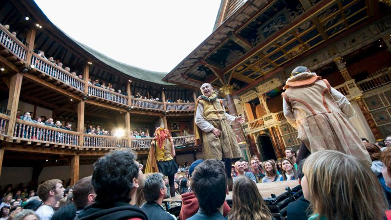 A large audience enjoy Footsbarns Shakespeare Party at the Globe Theatre, London, 25 May 2008. (Photo by Photofusion/Universal Images Group via Getty Images)