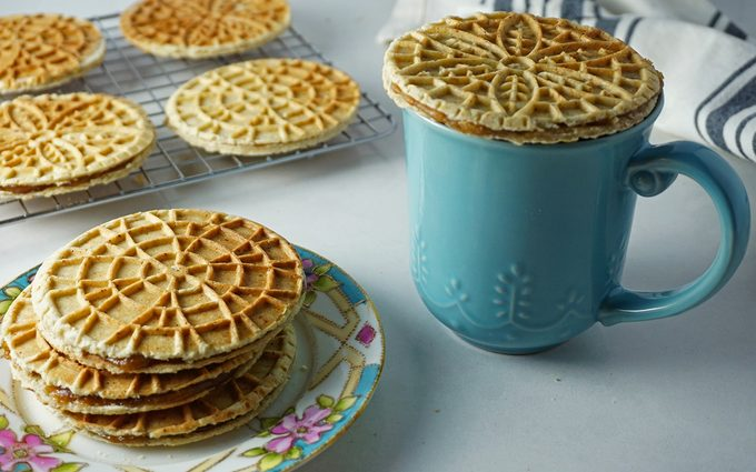 warming a stroopwafel over a cup of hot coffee