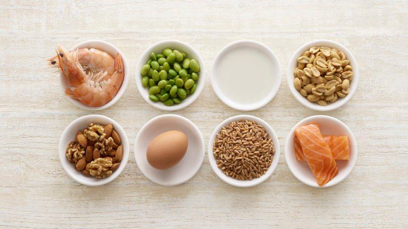 Allergenic foods in bowls, still life.