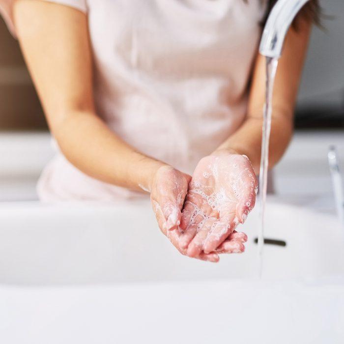 Closeup shot of an unrecognizable woman washing her hands