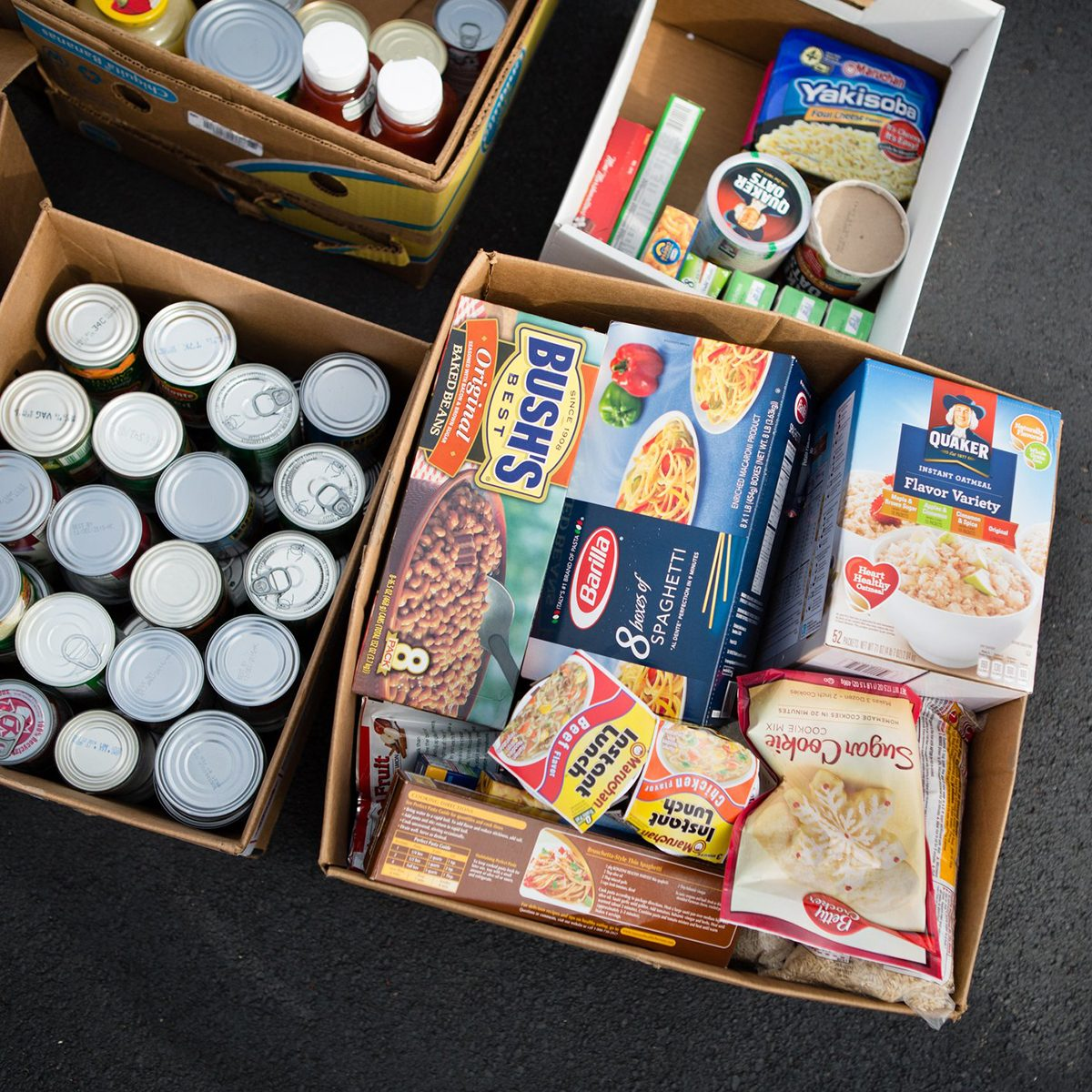 Boxes filled with cans and boxes of food