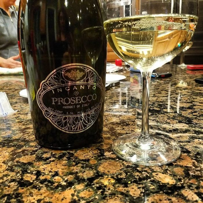 Incanto Prosecco bottle with glass.