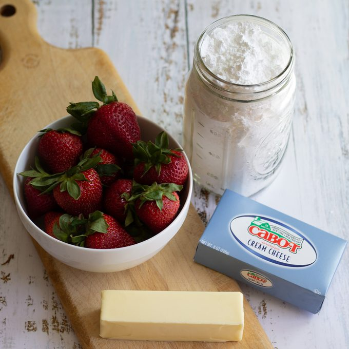 Ingredients for strawberry cream cheese frosting.